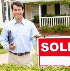 Man with Sold Sign in Hartford, CT